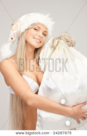 picture of cheerful santa helper girl with big bag