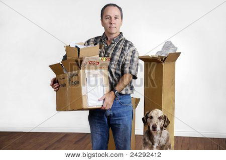 Middle Age Man And Dog Moving Out