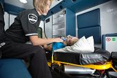 stock photo of triage  - Senior woman receiving emergency medical care in ambulance - JPG