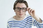 Surprised Young Man Staring At Camera Through Glasses. Surprising News Concept. Isolated Front View  poster