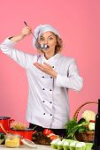 Female Chef Holds Spoon With Hot Food. Cooking And Professional Culinary Concept. Food Preparation C poster