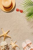 Top View Of Stylish Hat With Sunglasses And Sandals On Sandy Beach poster