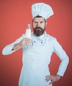 Chef With Confident Face In White Uniform Presents Milk. Best Drink Is Milk. Man With Beard And Must poster