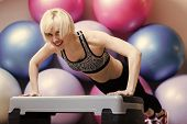 Sensual Sexy Woman. Girl In Sportswear Training On Step Platform In Gym. Happy Woman Athlete Do Push poster