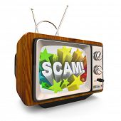 An old fashioned television shows the word Scam on an infomercial broadcast to cheat, deceive and em