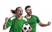 Young couple fan in green uniform celebrating poster