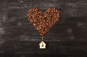 Coffee House And Coffee Beans Made In The Heart Shape Form On Black Wooden Surface Background With C poster
