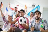 Cheerful And Happy Group Of Friends Watching Football Game On Tv. poster