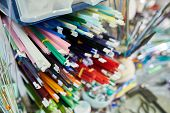 Close Up Of Bunch Of Colorful Glass Rods On Shelf By Workstation In Modern Glassworking Studio, Copy poster