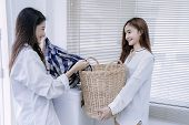Same Sex Couple Women Asian Doing Housework Or Chores Helping With Washing Machine Laundry Loading C poster