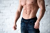 Fitness Concept. Muscular And Fit Torso Of Young Man Having Perfect Abs, Bicep And Chest. Male Hunk  poster