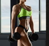 Cropped Close Up Of Strong Fit Models Body With Muscles. poster