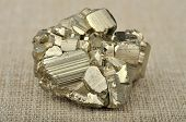 picture of pyrite  - pyrite in the background of a burlap - JPG