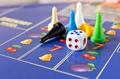 Multi-colored Game Chips With Dice On The Playing Board. Board Game. poster