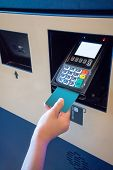 Hand Of Kid Inserting Credit Card Into Payment Machine For Payment. poster