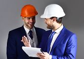 Boss Shows Project To Engineer With Cheerful Face. Engineer And Businessman Discuss Project. Happy E poster