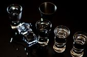 Traditional Pure Vodka In Glasses On A Black Background, Chilled Drink poster