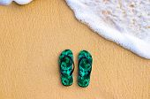 Beach Sandal Flip Flop On The Sand Beach With Smooth Sea Wave Bubble poster