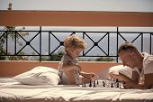 Kids Playing With Toys. Parent Play Chess With Kid On Terrace On Sunny Day. Father And Little Son Pl poster