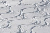 image of nordic skiing  - ski and snowboard tracks on powder snow - JPG