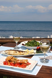 foto of summer beach  - healthy seafood for two by the sea - JPG