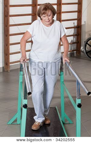 Portrait of mature woman having ambulatory therapy.