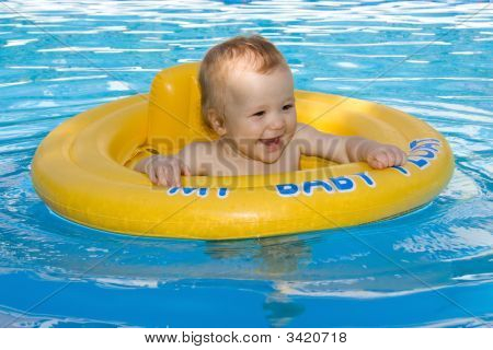 Beautiful Baby Girl Having Fun In The Family Pool