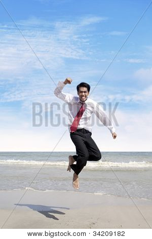 Success Bussinessman Jumps At Beach