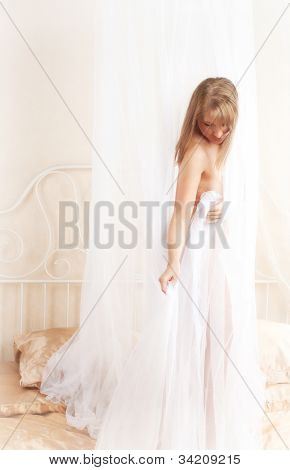 Young woman on gold bed