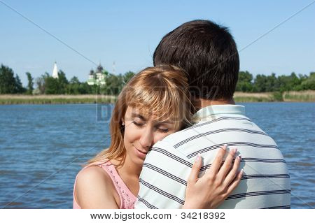Young Girl And The Guy On The River Bank