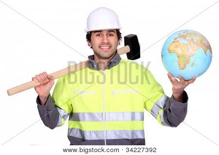 Tradesman holding a mallet and a globe