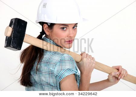 Woman carrying a mallet