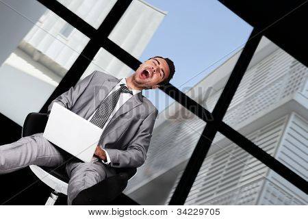 Businessman laughing hysterically