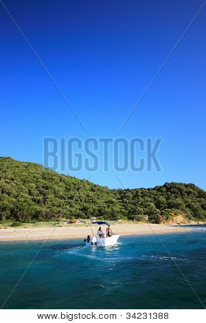 Couple on a speed boat at Marathonisi turtle island Zakynthos Greece