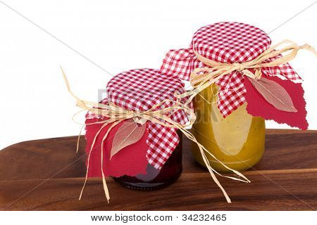 Homemade chutney gifts. On wooden table with white background