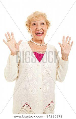 Senior woman raising her hands in praise, joy or surprise.  Isolated on white.