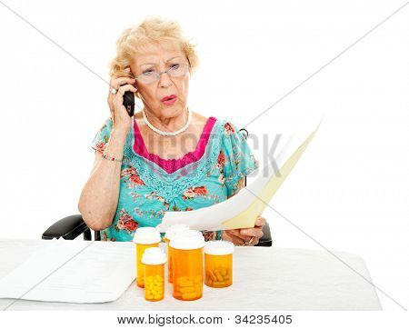 Disabled senior woman shocked by the cost of medical care and prescription medicine.  White background.