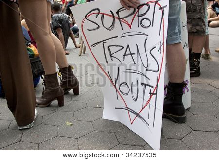NEW YORK - JUNE 22: A supporter holds a sign that says