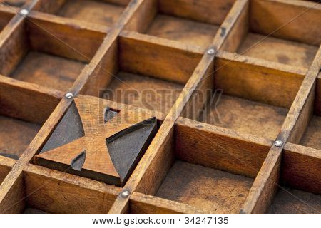 letter X abstract - vintage letterpress printing block in grunge wood typesetter box with dividers