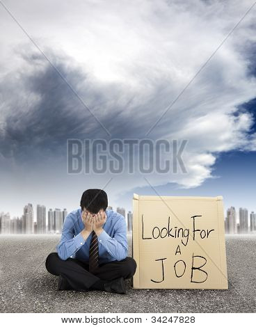 businessman looking for a job and city with storm coming