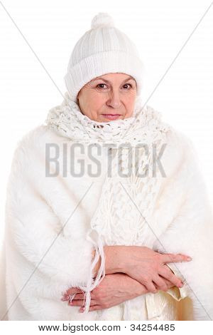 Portrait of pretty senior lady in winter cape