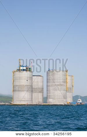 Base offshore oil drilling platform in a floating state. Sea Japan. Russian coast.