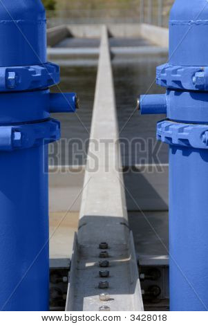 Blue Painted Pipes And Concrete