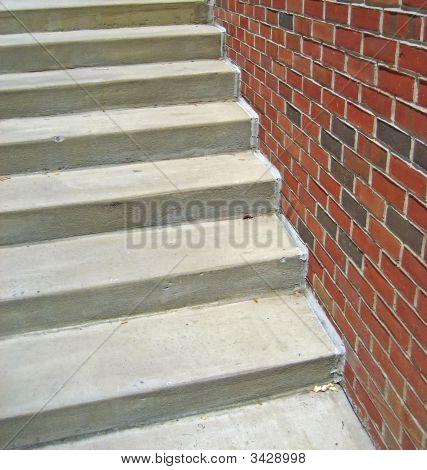 Cement Staircase Against Brick Wall