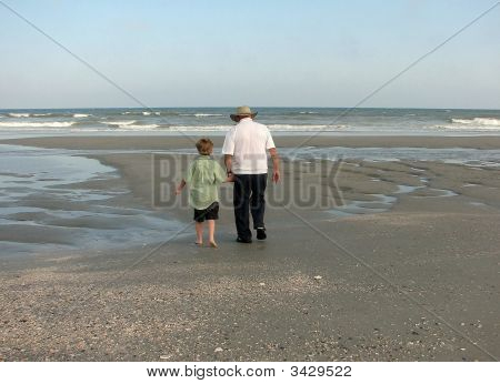 Grandpa & Grandson Walking On Beach