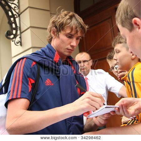 WARSAW, POLAND - JUNE 14: Anton Shunin, an association football goalkeeper who currently plays for Dynamo Moscow. Footballer is signing autographs, on June 14, 2012 in Warsaw, Poland.