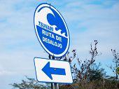 ruta De Desalojo Sign In Spanish Language Mean evacuation Route In English Language. Tsunami Eva poster