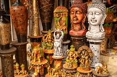 Variety Of Hindu And Buddhism Buddha Statues And Gods For Sale At A Market In New Delhi India poster
