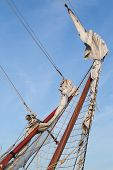 stock photo of big-rig  - Rigging bowsprit of big sailing ship against a blue sky - JPG