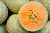 stock photo of honeydew melon  - Honeydew melons seen on a weekly fruit market - JPG